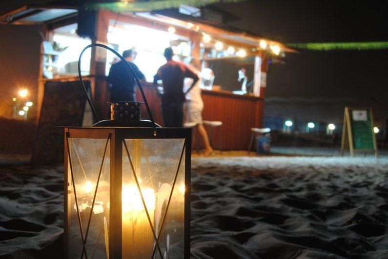 Beach bar candle on sand