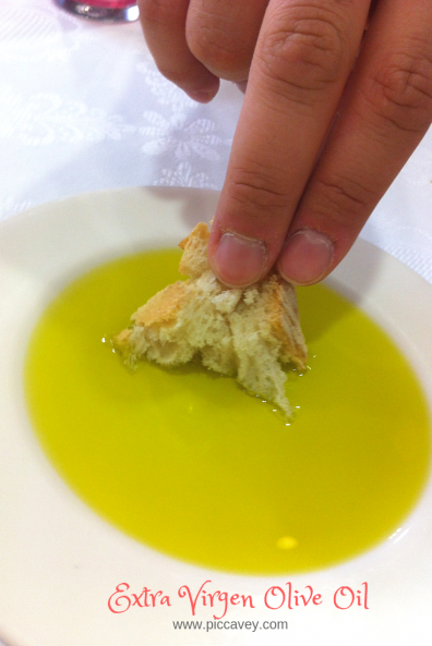 Dipping Bread in extra Virgen Olive Oil